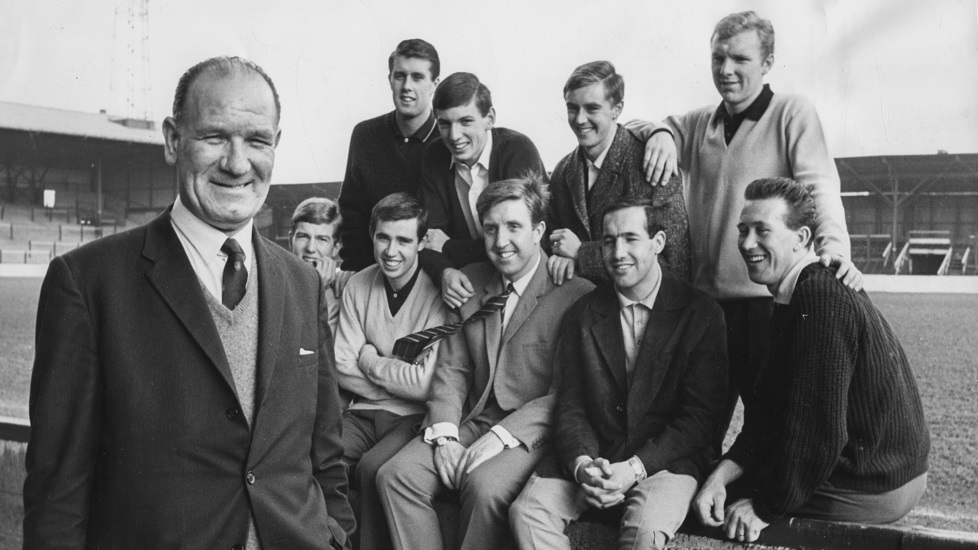 Football talent scout Wally St Pier (left) pictured with a group of West Ham United players whom he discovered early in their careers; (L-R) Geoff Hurst, Martin Peters, John Sissons, Bobby Moore, Jack Burkett, Ronnie Boyce, John Bond, Eddie Bovington and Ken Brown, prior to the teams FA Cup match against Burnley FC, at Upton Park, London, February 28th 1964. (Photo by Keystone/Hulton Archive/Getty Images)